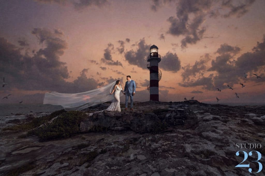A Bride and Groom Standing by the Lighthouse during their Destination Wedding at The Hyatt Ziva Cancun